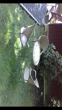 Wrought iron &wicker 30 inch bistro set with three chairs $50 Blakeslee, 18610