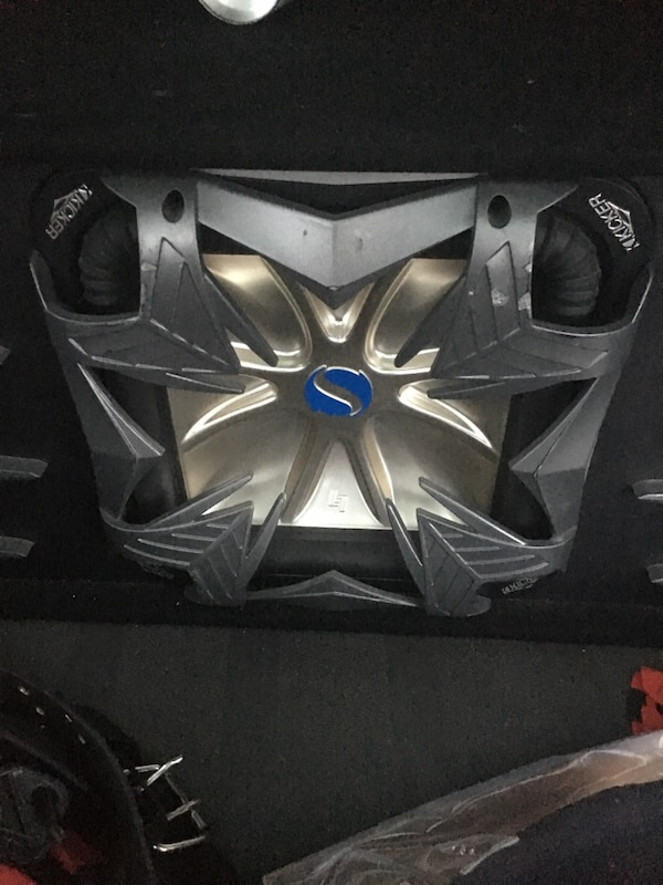 Gray and black kicker solo baric subwoofer speaker