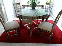round glass top table with four chairs dining set Coquitlam, V3E 3L9