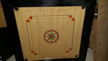 Carrom Board.  With Coins.
