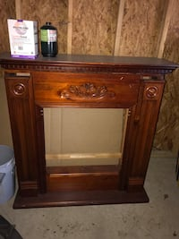 brown wooden fireplace mantel
