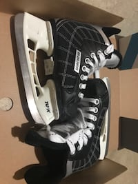 pair of black-and-grey Bauer ice-hockey skates Edmonton, T5W 4R4