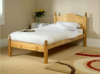 white bed sheet and brown wooden bed frame Toronto, M4K 2C3