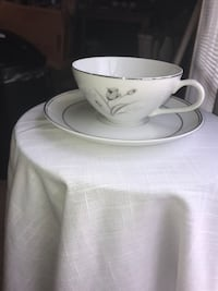 white and gray floral ceramic teacup with saucer 64 km