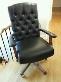 black leather padded rolling chair Toronto, M2L 1W4