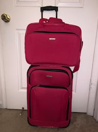 Pink carry on suitcase and personal item set.