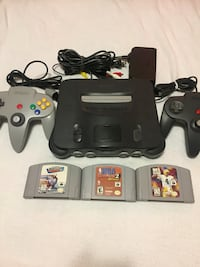 Black nintendo 64 console, two controllers, all hookups an three sports games pictured -$100- everything in good working condition. Would consider trades for other N64 games Regina, S4R 1V8