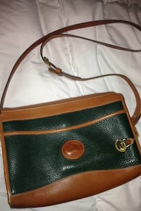 green and brown leather cross body bag