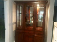 brown wooden framed glass display cabinet Edmonton, T6R 1A2