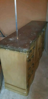 Stone dresser comes with night stands and mirror  Surrey