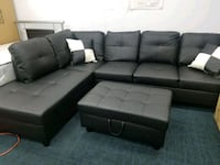 Black faux leather sectional with storage Ottoman  College Park