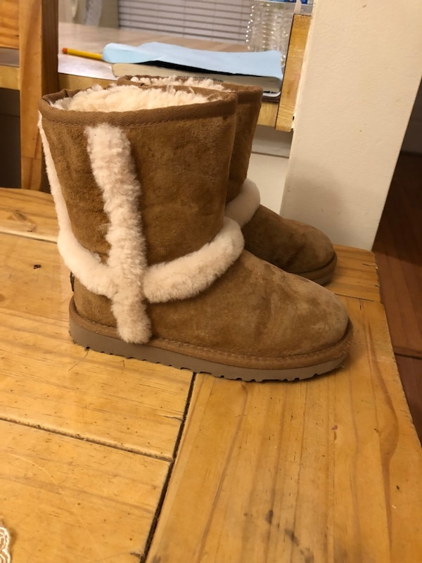 pair of brown sheepskin boots