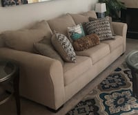 Tan Sofa 4 throw pillows. 2 in middle not included.