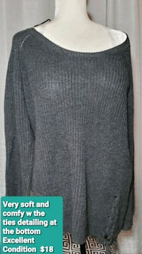 Wooley knit sweater with tie up details at the bottom on sides