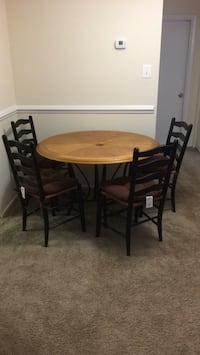 Round brown wooden table with four chairs dining set 46 km