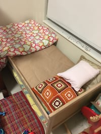 Toddler bed with railing and mattress included.