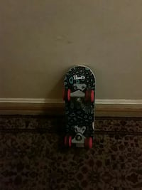 black and red Paul's skateboard 40 km