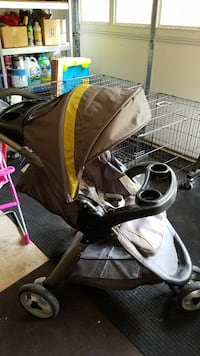 baby's brown and black jogging stroller Kennesaw, 30144