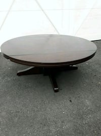round brown wooden pedestal table Langley