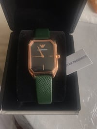 Emporio Armani gold plated stainless steel with green leather strap watch, Never once used, comes with original box watch holder barcode and plastic screen protector , price is negotiable but not for a lot , watch comes as new as the come Newark, 07106