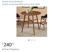 round brown wooden table with four chairs dining set Brampton, L6S 3W3