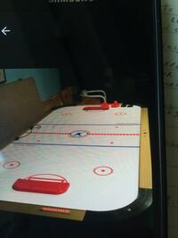 white and red air hockey table 9frx4ft