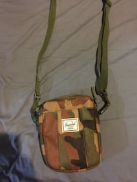 brown and green leather crossbody bag