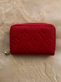 red leather bi-fold wallet 62 km