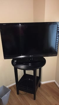 black flat screen TV with black wooden TV stand Mc Lean, 22102
