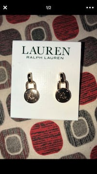 silver-colored earrings with text overlay Orlando, 32827