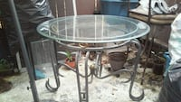 round clear glass top table with black metal base Riverside, 92504