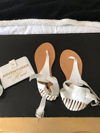 Pair of white-and-brown leather thong flat sandals