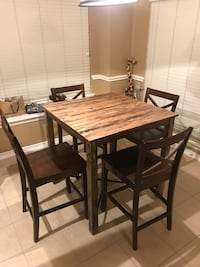 rectangular brown wooden table with four chairs dining set Tomball, 77375