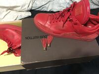 Pair of red nike basketball shoes with box