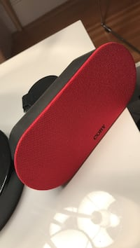 red and gray Coby portable speaker