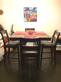 brown wooden dining table with four chairs Toronto, M5J 2S3