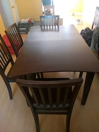 rectangular brown wooden table with four chairs di College Park, 20740