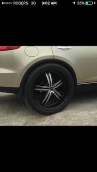Grey 5-spokes car wheel with tire screenshot