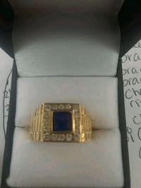 gold-colored ring with blue gemstone Houston, 77037