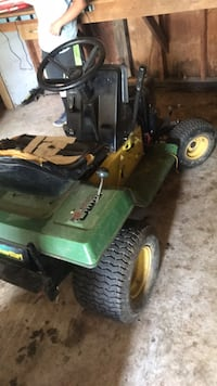 green and yellow John Deere ride on lawn mower 42 km