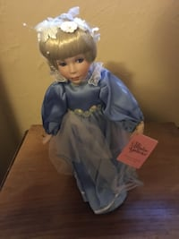 Glass doll collectible St Paul