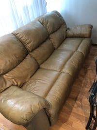 Two tan leather full recliners SAINTMICHAEL