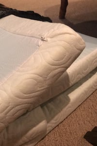 Foam mattress topper for a twin bed.