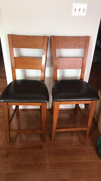 two brown wooden framed black leather padded chairs Silver Spring, 20905