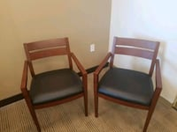 2 Wood guest chairs- black leather seat Arlington