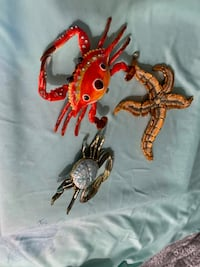 Three articulated metal sea creatures perfect for your beach style.  All three for $10 Dunedin, 34683