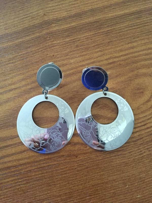 pair of round silver pendant earrings