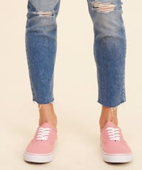 Women's pink lace-up low-top sneakers.