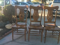 four brown wooden chairs with brown leather pads 2260 mi