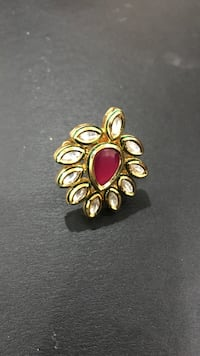 Gold plated with red diamond and accessory